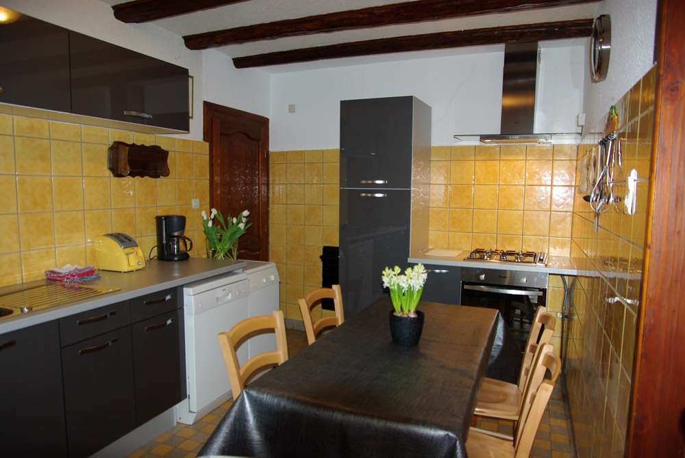 A comfortable kitchen, equipped with washmachine, dishmachine, micro-wave, great place of arrangements